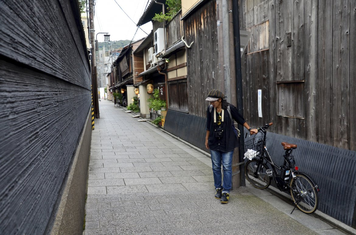 Traveller and japanese people go to most popular area of Gion is Hanami-koji Street from Shijo Avenue to Kenninji Temple at Gion district on July 11, 2015 in Kyoto, Japan
